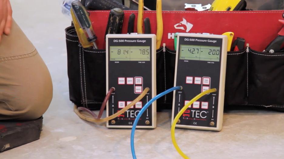 DG-500 micromanometers resting against tool bag in basement