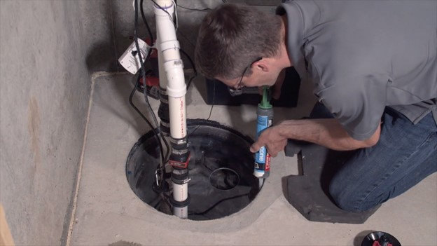 Sealing sump pump cover to lower radon and increase energy efficiency of the radon system