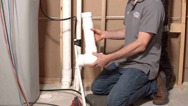 Three inch T connects directly to the drain tile and should be free of rock and debris